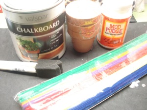 Materials: Chalkboard paint, small flowers pots purchased from The DollarTree, Mod Podge, foam brushes, pipe cleaners, white spoons